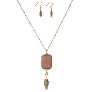 "Gold tone necklace set featuring a gray and pink shimmering epoxy stone pendant and matching fishhook earrings. Approximately 30"" in length."