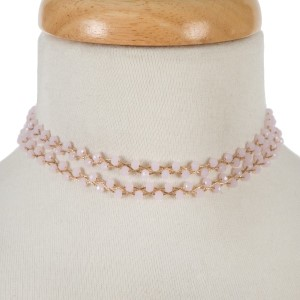 "Gold tone, wire wrapped, two layer pink beaded choker with matching stud earrings. Approximately 12"" in length."