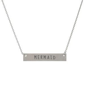 "Matte silver tone bar necklace stamped with ""Mermaid."" Approximately 14"" in length."