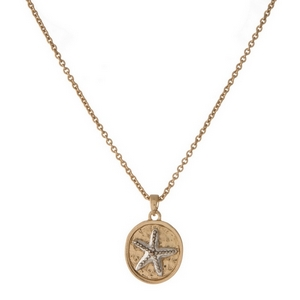 "Dainty gold tone necklace with a small two-tone starfish pendant. Pendant approximately 10mm. Length adjusts from 16""-18""."