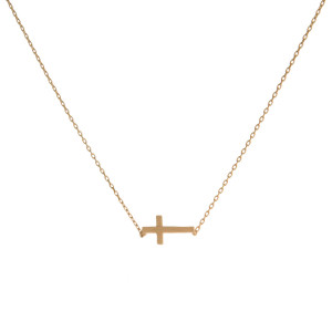 "Dainty gold tone necklace featuring a brushed cross pendant. Pendant approximately 8mm in length. Length adjusts from 16""-18""."