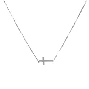 "Dainty silver tone necklace featuring a brushed cross pendant. Pendant approximately 8mm in length. Length adjusts from 16""-18""."