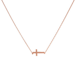 "Dainty rose gold tone necklace featuring a brushed cross pendant. Pendant approximately 8mm in length. Length adjusts from 16""-18""."