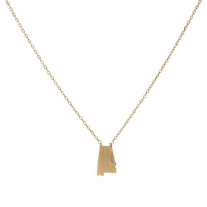 "Dainty gold tone necklace featuring a brushed Alabama shaped pendant. Pendant approximately 7mm in length. Length adjusts from 16""-18""."