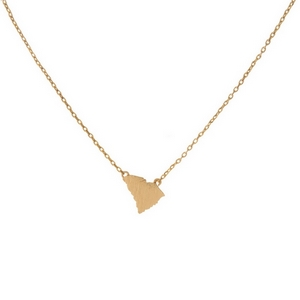 "Dainty gold tone necklace featuring a brushed South Carolina shaped pendant. Pendant approximately 7mm in length. Length adjusts from 16""-18""."
