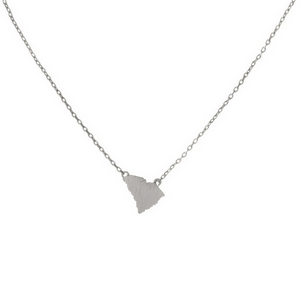 "Dainty silver tone necklace featuring a brushed South Carolina shaped pendant. Pendant approximately 7mm in length. Length adjusts from 16""-18""."