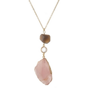 "Gold tone necklace with a pink agate stone pendant and a gray bead accent. Approximately 28"" in length."
