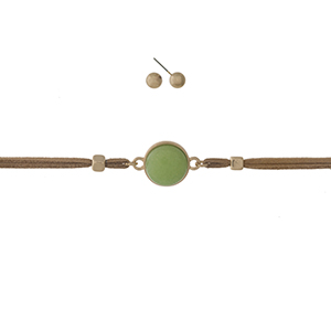 """Tan faux suede choker featuring a lime green focal and gold tone stud earrings. Approximately 12"""" in length."""