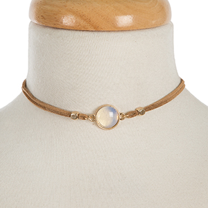 """Tan faux suede choker featuring a moonstone focal and gold tone stud earrings. Approximately 12"""" in length."""