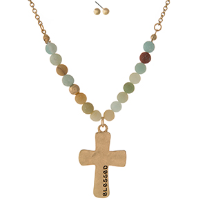 "Gold tone necklace set displaying a cross pendant, stamped with ""Blessed"" and accented with amazonite natural stone beads. Approximately 16"" in length."