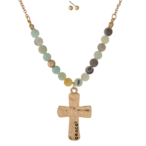 "Gold tone necklace set displaying a cross pendant, stamped with ""Grace"" and accented with amazonite natural stone beads. Approximately 16"" in length."