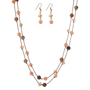 "Brown cord wrap necklace featuring knotted peach natural stone beads and matching fishhook earrings. Approximately 72"" in length."