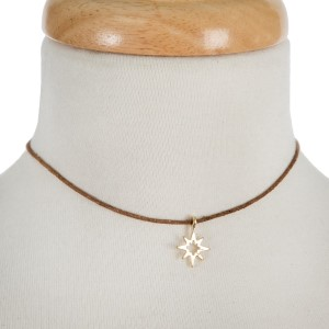"""Brown waxed cord choker with a gold tone star pendant. Approximately 12"""" in length."""