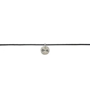"""Black faux leather cord choker with a silver tone disc pendant. Approximately 12"""" in length."""