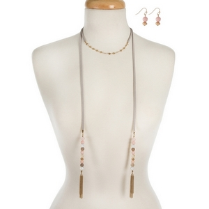 """Faux gray suede choker and wrap necklace displaying pale pink natural stone beads and gold tone tassels. Approximately 12"""" and 40"""" in length."""