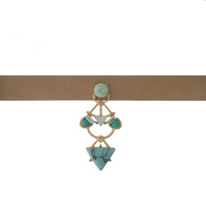 """Tan faux leather choker with a turquoise and gold tone focal. Approximately 12"""" in length."""