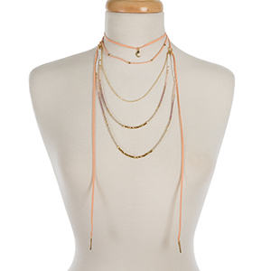 """Peach faux suede and gold tone layered choker with white and mauve beads. Approximately 12"""" to 32"""" in length."""