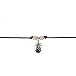 """Black faux leather cord choker with a silver pineapple pendant and freshwater pearls. Approximately 12"""" in length."""