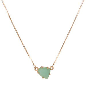 """Dainty gold tone necklace with a mint green stone pendant. Approximately 16"""" in length."""