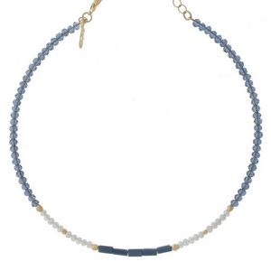 "Gold tone memory wire choker featuring navy blue, white and light blue faceted beads. Approximately 5"" in diameter with a 3"" extender."