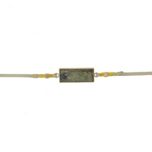 """Tan faux suede choker featuring a labradorite stone focal and gold tone and yellow thread accents. Approximately 12"""" in length."""