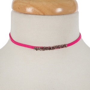 "Hot pink faux suede choker with hematite and gray stones. Approximately 12"" in length."