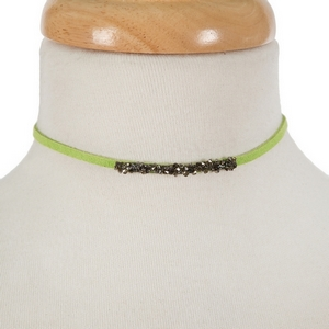 "Lime green faux suede choker with hematite and gray stones. Approximately 12"" in length."