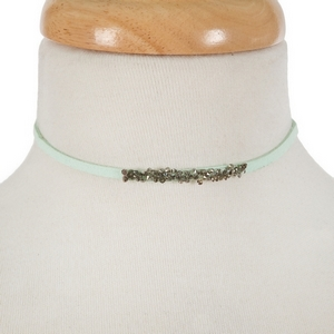 "Mint green faux suede choker with hematite and gray stones. Approximately 12"" in length."
