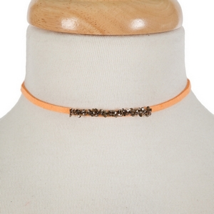 "Orange faux suede choker with hematite and gray stones. Approximately 12"" in length."