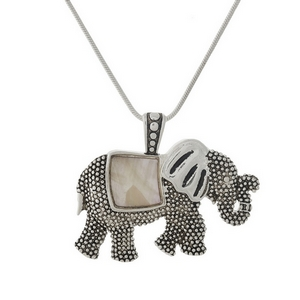 "Silver tone necklace with a mother of pearl elephant pendant. Approximately 18"" in length."