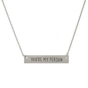 "Dainty silver tone necklace displaying a bar stamped with ""You're My Person."" Approximately 16"" in length."