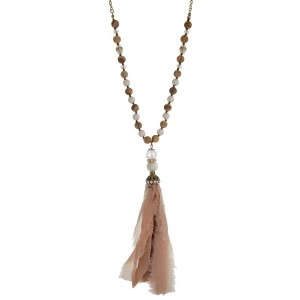 """Gold tone necklace with picture jasper natural stone beads and a neutral colored fabric tassel. Approximately 33"""" in length."""