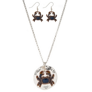 "Silver tone necklace set featuring a circle pendant stamped with ""Beach Life"" and accented with a blue crab. Approximately 30"" in length."