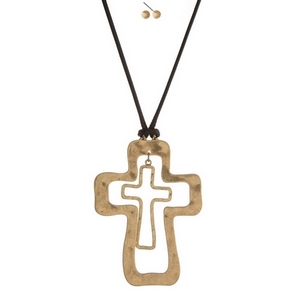 """Black cord necklace set with a hammered gold tone cross pendant. Necklace is approximately 34"""" in length and pendant is 4"""" in length."""