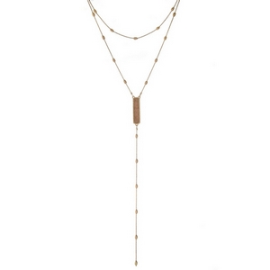 """Dainty gold tone two layer necklace displaying a peach stone on the 'Y' layer. Approximately 12"""" and 17"""" in length."""