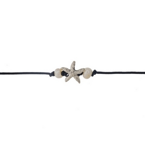 "Black waxed cord choker displaying a starfish focal accented with two freshwater pearl beads. Approximately 12"" in length."