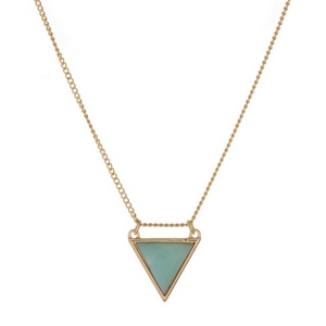 "Dainty gold tone necklace displaying a mint green, semi-precious, triangle stone pendant. Approximately 16"" in length."