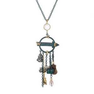 """Patina necklace displaying a """"Happy Camper"""" charmed pendant. Approximately 30"""" in length."""