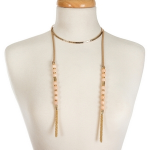 """Gold tone open metal choker featuring tan faux suede pieces with peach natural stone beads and chain tassels. Approximately 16"""" in length."""