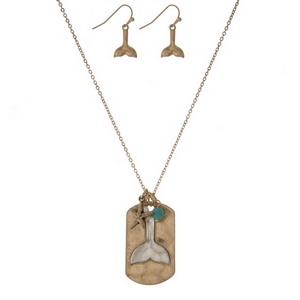 "Gold tone necklace set displaying a two tone whale tale pendant and matching fishhook earrings. Approximately 16"" in length."