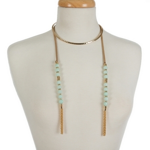 """Gold tone open metal choker featuring tan faux suede pieces with mint green natural stone beads and chain tassels. Approximately 16"""" in length."""
