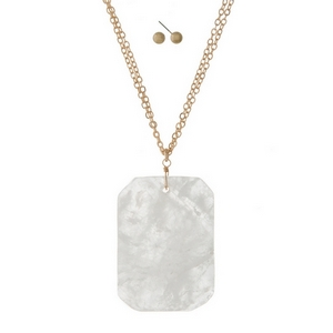 """Gold tone necklace set featuring a white stone pendant and gold tone stud earrings. Approximately 32"""" in length."""