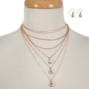 """Rose gold tone, multi layer choker necklace set featuring clear rhinestone pendants and matching fishhook earrings. Approximately 12"""" to 16"""" in length."""