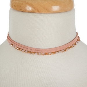 """Mauve pink faux suede and beaded choker with matching fishhook earrings. Approximately 12"""" in length."""