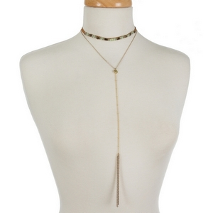 """Dainty two layer choker necklace featuring a mint and gold beaded choker and a 'Y' layer with a chain tassel. Approximately 12"""" and 14"""" in length."""