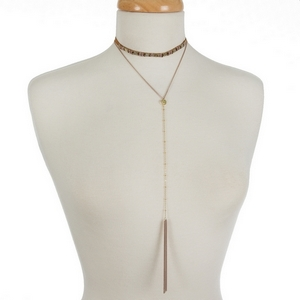 """Dainty two layer choker necklace featuring a mauve and champagne beaded choker and a 'Y' layer with a chain tassel. Approximately 12"""" and 14"""" in length."""