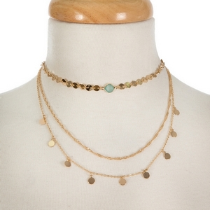 """Dainty three layer, gold tone choker featuring a mint green stone focal. Approximately 12"""" to 16"""" in length."""