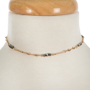 """Dainty gold tone choker featuring hematite faceted beads. Approximately 13"""" in length."""