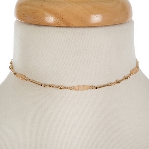 """Dainty gold tone choker featuring champagne faceted beads. Approximately 13"""" in length."""