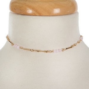 """Dainty gold tone choker featuring pale pink faceted beads. Approximately 13"""" in length."""